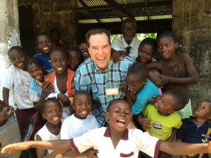 Photo of Gary with a group of Liberian children