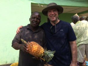 Photo of Pastor Gary with a pineapple in Liberia