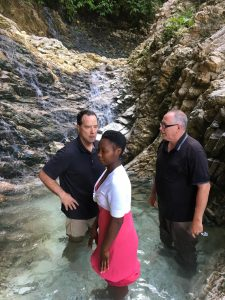 Photo of pastors baptizing a Haitian woman